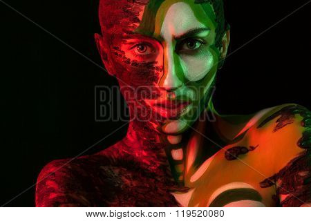 Woman With Clay On Face And Body Painting