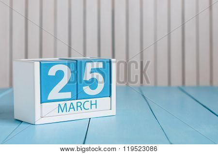 March 25th. Image of march 25 wooden color calendar on white background.  Spring day, empty space fo