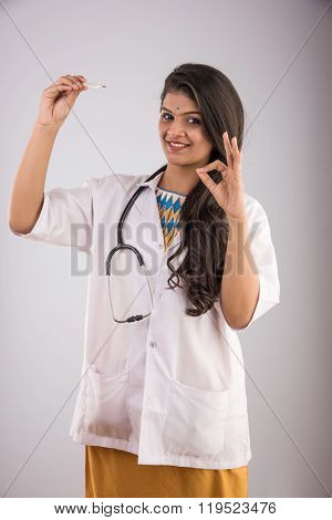 indian female doctor with thermometer, asian female doctor and thermometer, indian young medical pra