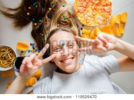 Unhealthy Concept. Woman With Unhealthy Food: Pizza, Lemonade, Chips, Candy And Chips.