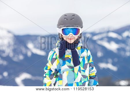 Young Child, Skiing On Snow Slope In Ski Resort In Austria