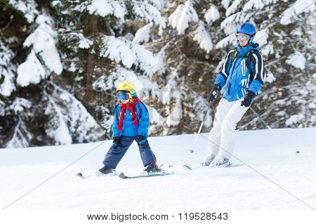 Father And Son, Preschool Child, Skiing In Austrian Ski Resort In The Mountains