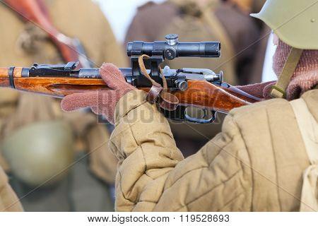 soldier or sniper hands holding gun