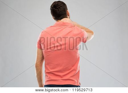 people, healthcare and problem concept - man suffering from neck pain