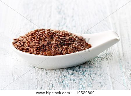 Flax Seeds In White Porcelain Spoon