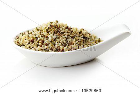 Hemp Seeds In White Porcelain Spoon