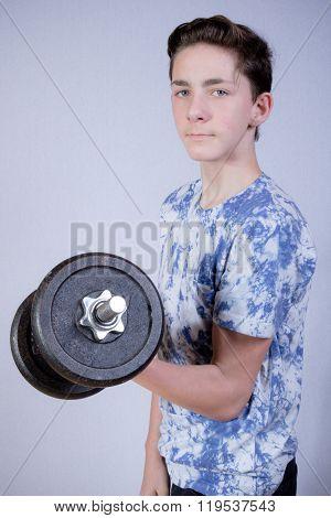 Teenage Boy Doing Strength Training