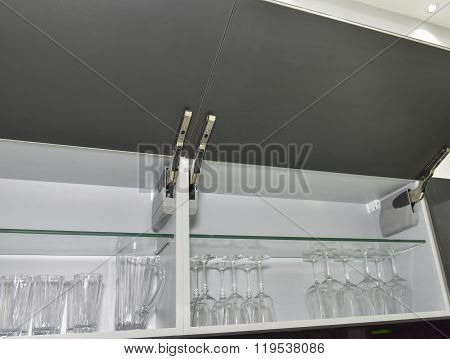 Kitchen Cupboard With Glasses On Shelf