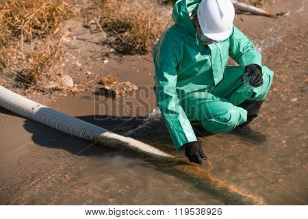 Water Quality Inspector Taking Sample