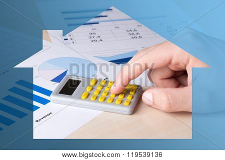 Business And Real Estate Concept - Graphs, Charts And Male Hand With Calculator