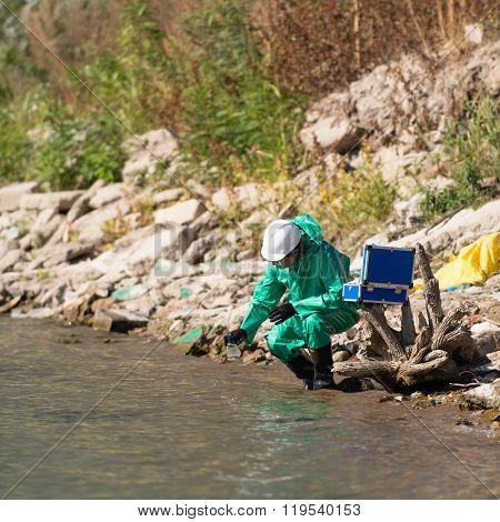 Environmentalist Taking Sample Of Water