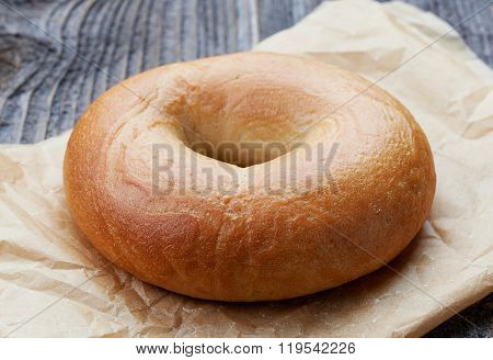 Fresh Bagel On Wooden Table