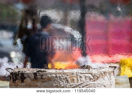 Heat During Casting Of Buddha Images