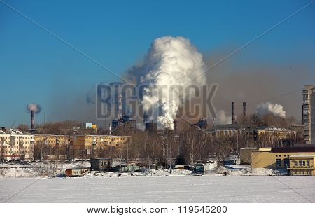 Smoke against the background of the city. Nizhny Tagil. Russia.