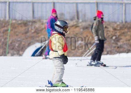 Side View Of Little Boy At Ski Resort