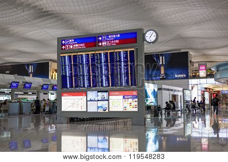 Airport Timetable Board In Airport Terminal