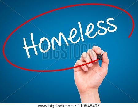 Man Hand Writing Homeless With Black Marker On Visual Screen.