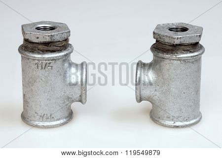 Cast iron galvanized fittings for water on a white background.