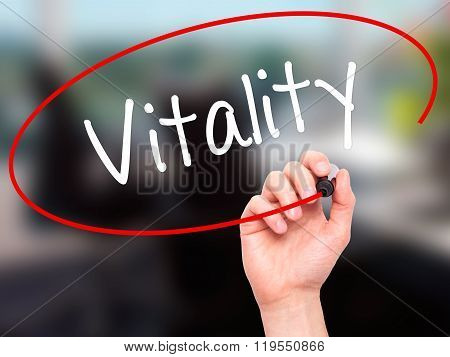 Man Hand Writing Vitality  With Black Marker On Visual Screen.