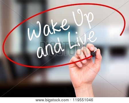 Man Hand Writing Wake Up And Live With Black Marker On Visual Screen.