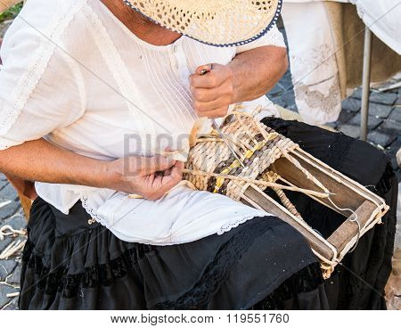 Elderly Lady Builds Hand Woven Baskets.