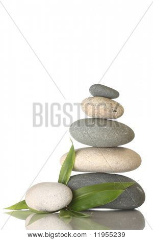 Stacked pebbles & bamboo leaf