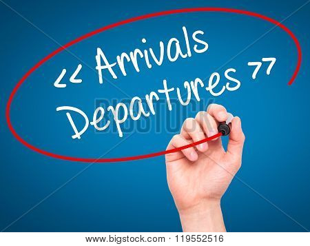 Man Hand Writing Arrivals - Departures With Black Marker On Visual Screen.