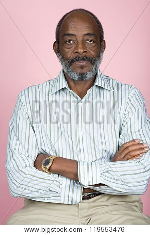 Senior man with crossed arms