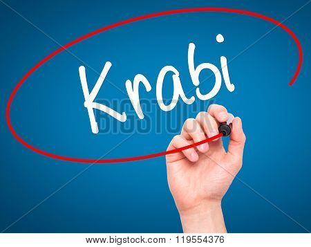Man Hand Writing Krabi  With Black Marker On Visual Screen.