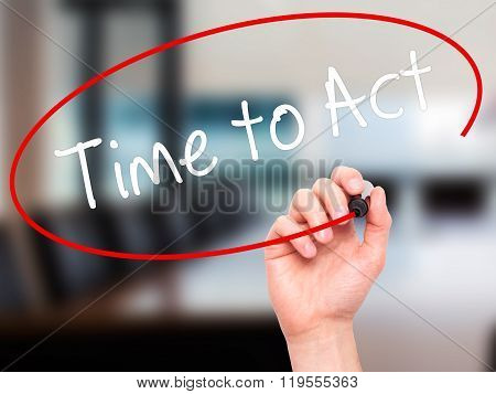 Man Hand Writing Time To Act With Black Marker On Visual Screen.