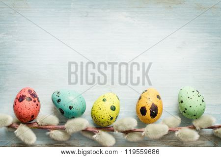Easter egg and catkins retro blue background