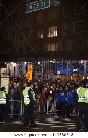 NEW YORK - NOV 25 2015: Crowds of people wait on 79th St across from the Museum of Natural History to enter the Macy's Giant Balloon Inflation event the night before the 89th Thanksgiving Day Parade.