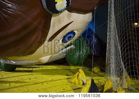NEW YORK - NOV 25 2015: Macys animated character Virginia novelty balloon tied down with sandbags and netting during Macy's Giant Balloon Inflation event held the day before Thanksgiving in Manhattan.
