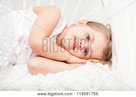 Cute Little Girl In White Pretending Sleep