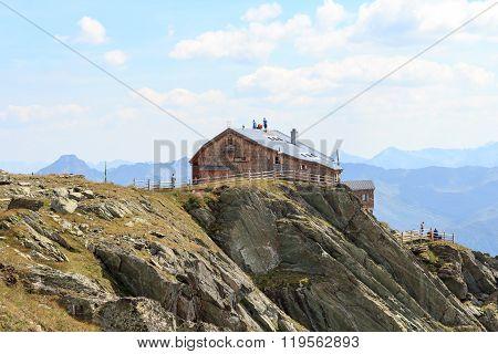 Craftsmen Standing On The Roof Of Alpine Hut Bonn Matreier Hutte In Hohe Tauern Alps, Austria