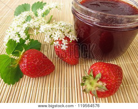 Jam with strawberries and elderflowers