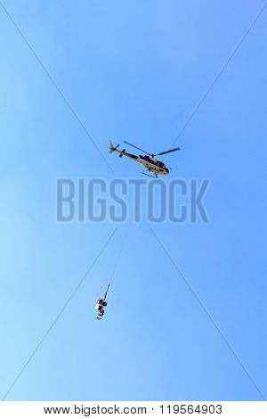 Transport is helicopter flying with supplies, Austria