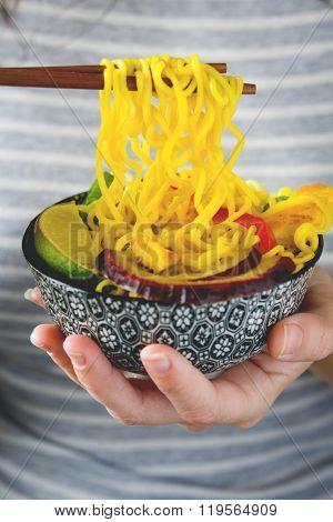 Woman eating thai noodles