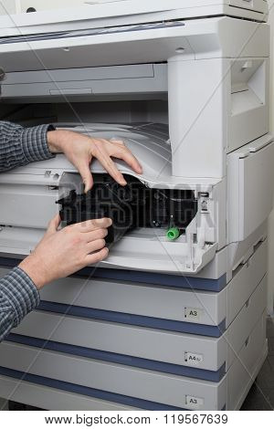 Handyman Fixing The Office Printer At An Office