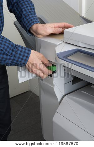 Handyman Fixing The Office Printer At Work