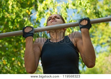 Female Doing Pull Ups