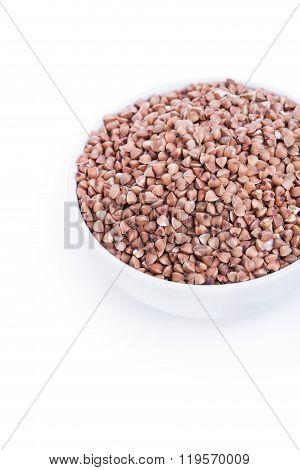 Dry Buckwheat In White Bowl