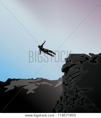silhouette jump from a high cliff