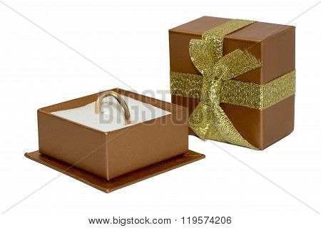 Golden Wedding Ring In Open Gift Box Isolated On White Background