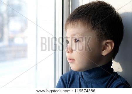 Boy Looking Out The Window And Thinking Philosophical
