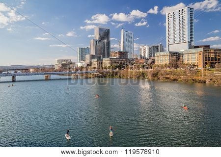 Panorama Of Downtown Austin And People Kayaking At Colorado  River