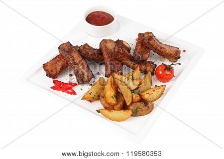 Single Spareribs With Potato Sliced On White Square Serving Dish.