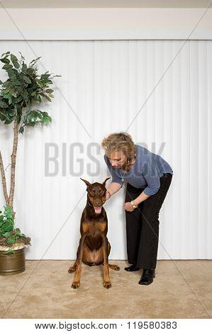 Woman with pet Doberman