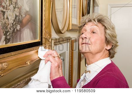 Woman polishing picture frames