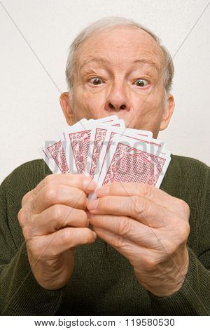 Elderly man with playing cards